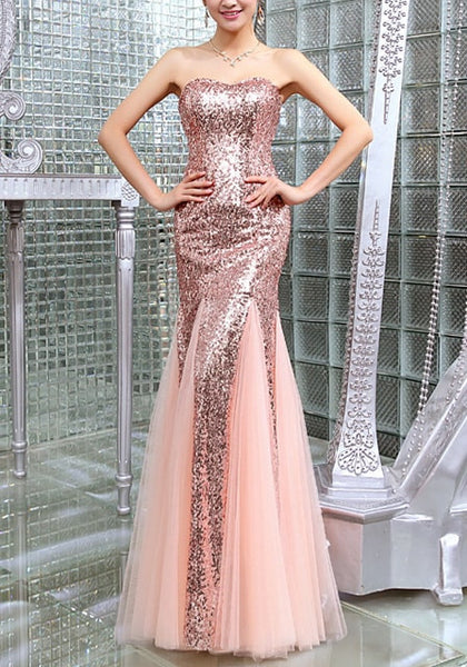 Pretty model wearing peach sequin mermaid evening gown