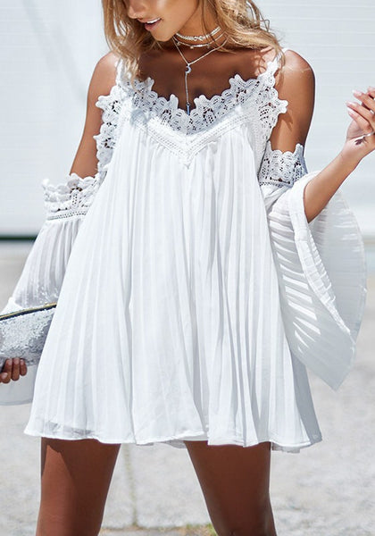 Pretty model wearing white cold-shoulder pleated shift dress