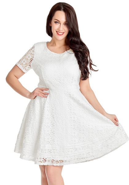 Pretty model wearing white floral hollow lace short sleeves skater dress