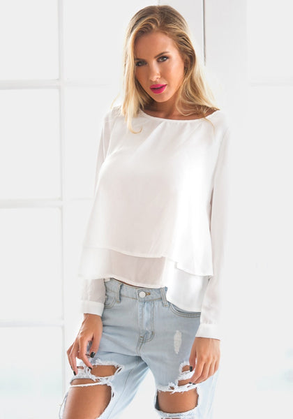 Pretty model wearing white layered chiffon blouse