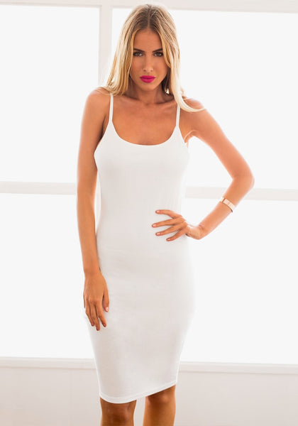 Pretty model wearing white ribbed cami bodycon dress