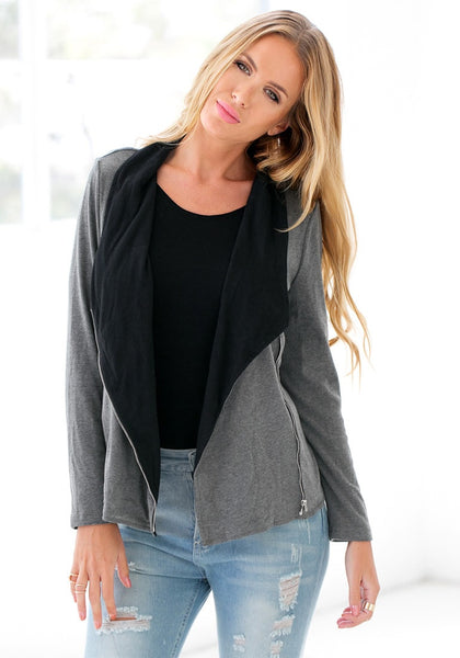 Renee is wearing grey oblique zipper cardigan with black top