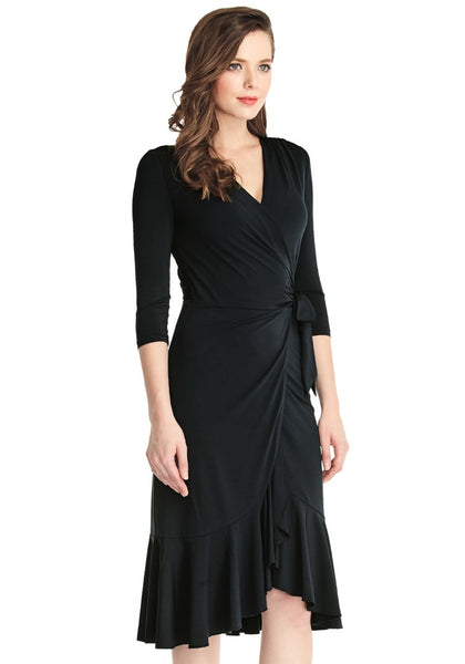Right angle shot of woman in black asymmetrical ruffled wrap dress