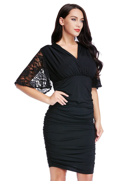 Right angle shot of woman in plus size black ruching bodycon dress