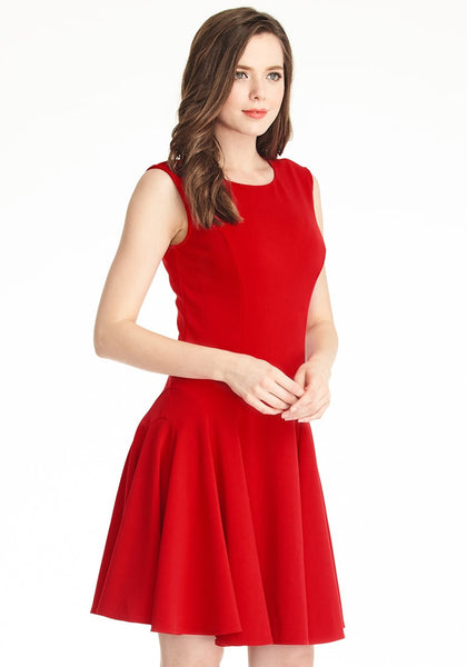 Right angle shot of woman in red sleeveless skater dress