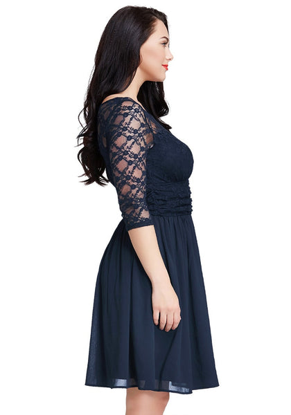 Right angle view of model wearing plus size navy lace crop-sleeves skater dress