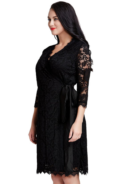 Right angled shot of lady in black lace crop sleeves wrap dress