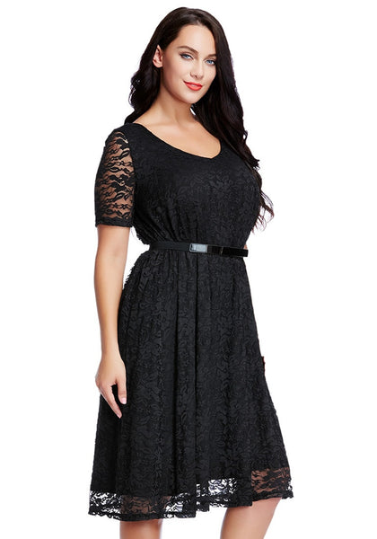 Right angled shot of lady in plus size black lace midi dress