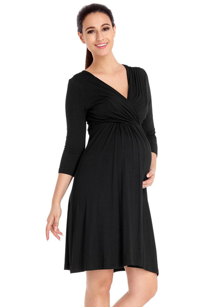 Right angled shot of model in black V neckline ruched surplice maternity dress