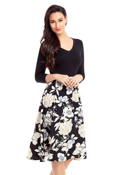 Right angled shot of model in black floral-bottom V neckline crop sleeves skater dress