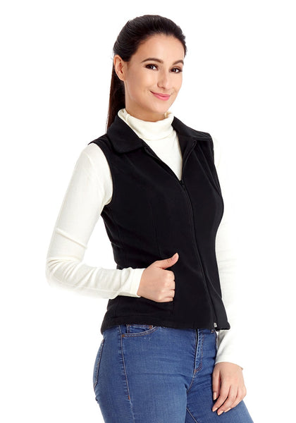 Right angled shot of model in black zip-up collared fleece vest