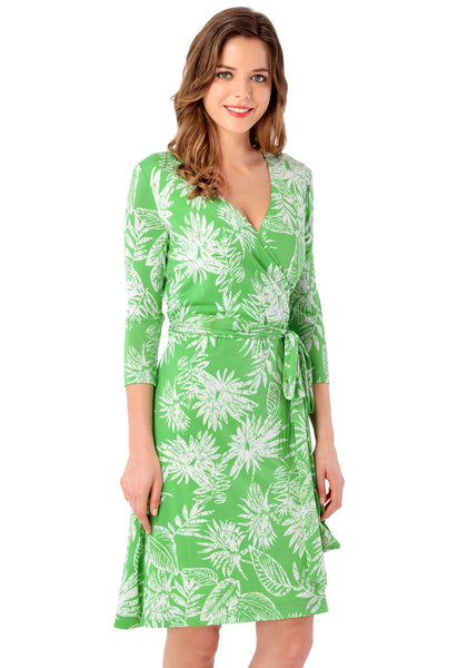 Right angled shot of model in light green plant-print crop sleeves wrap dress