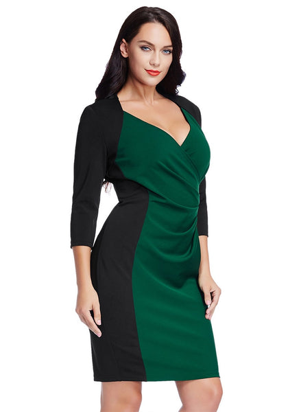 Right angled shot of model in plus size green raglan sleeve dress