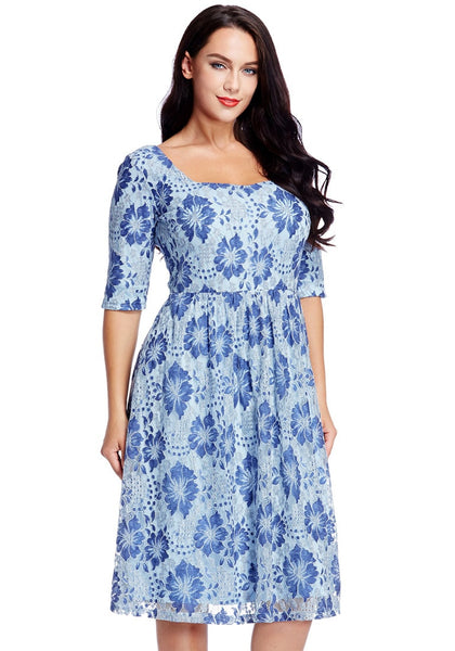 Right angled shot of model in plus size light blue floral-print lace dress
