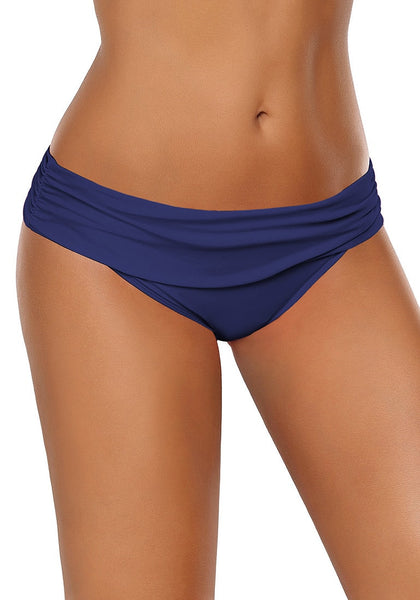 Right angled shot of model wearing navy shirred waistband swim bottom