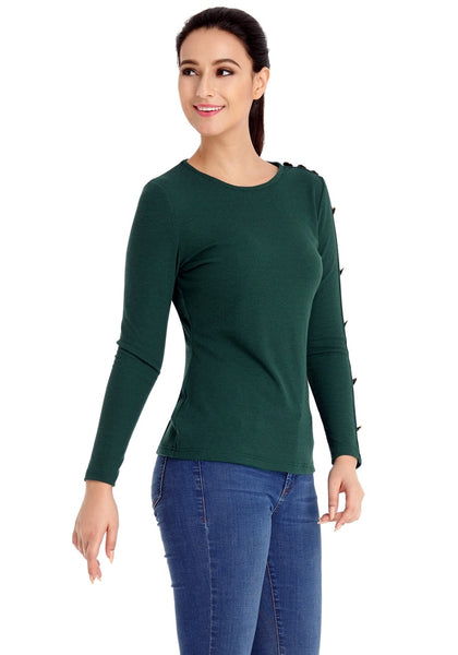 Right angled shot of model wearing pine green button-embellished fitted top