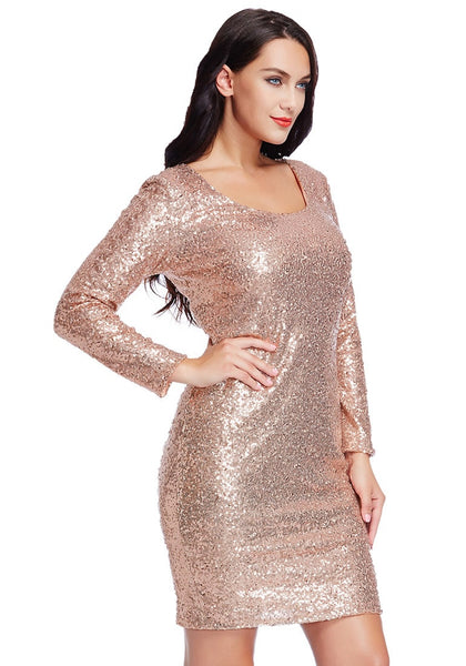Right angled shot of model wearing plus size champagne sequined party dress with one hand on the waist