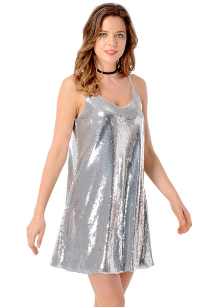 Right angled shot of model wearing silver sequins slip dress