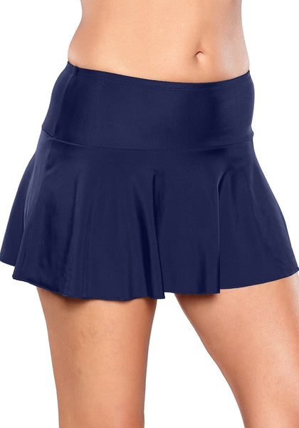 Right angled shot of model wearing solid navy flared swim skirt
