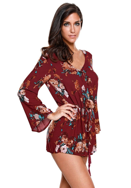 Right angled shot of woman in maroon floral trumpet sleeve surplice romper