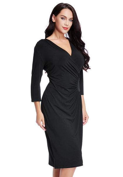 Right angled view of model black side-patch wrap midi dress