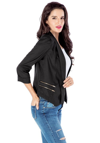 Right angled view of model in black crop sleeves lapel blazer