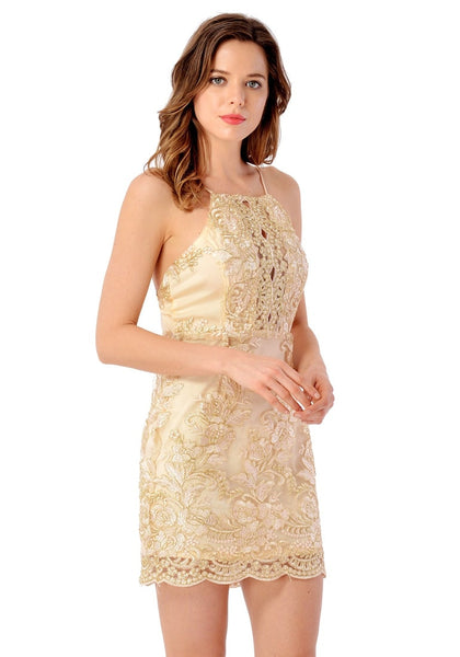 Right angled view of model in champagne floral embroidered scallop slip dress