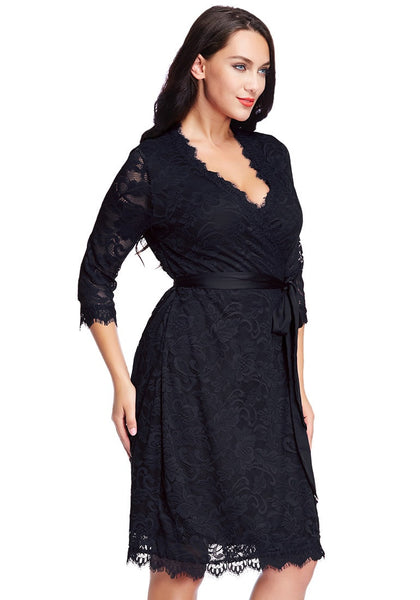Right angled view of model in plus size navy lace crop sleeves wrap dress