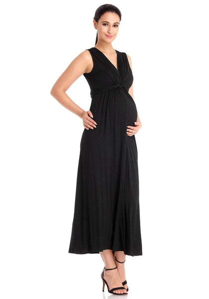 Right angled view of model wearing black sleeveless A-line long maternity dress