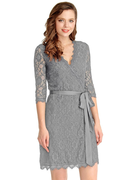 Right angled view of woman in grey lace overlay plunge wrap-style dress