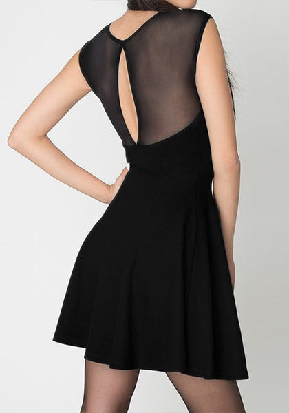 Right back view of model in black illusion-neck sleeveless mini dress