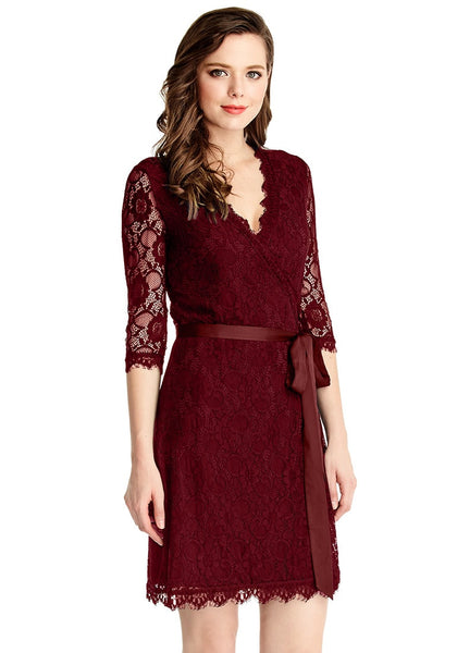 Right side angled view of model in burgundy lace overlay plunge wrap-style dress