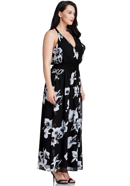 Right side shot of black floral-printed plunge maxi dress worn by model