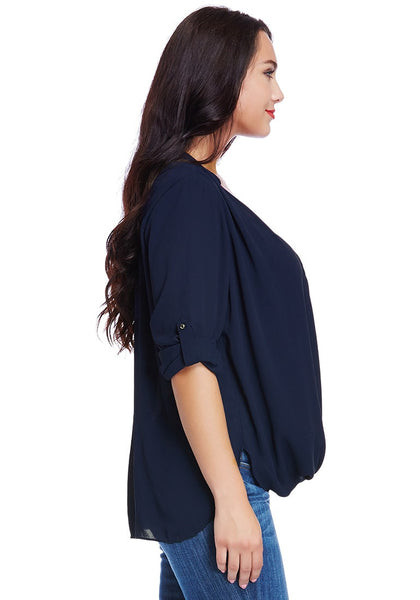 Right side shot of lady in plus size navy blue Mandarin collar surplice shirt