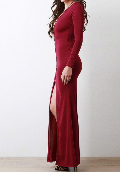 Right side shot of model in a burgundy lace-up long dress