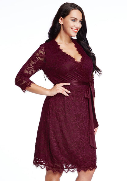 Right side shot of model in plus size burgundy lace crop sleeves wrap