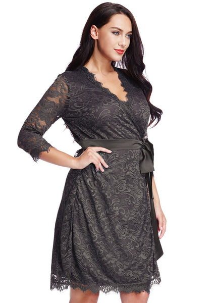 Right side shot of model in plus size grey lace crop sleeves wrap dress