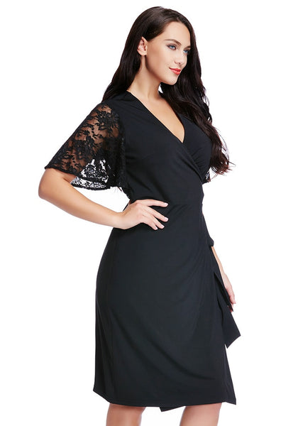 Right side shot of woman in plus size black plunge wrap-style dress