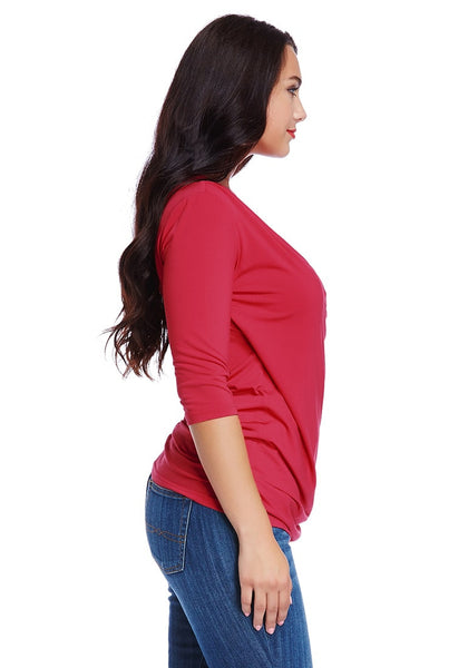 Right side shot of woman in plus size red ruched surpliced top