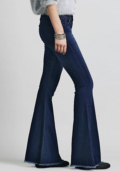 Right side view of blue bell-bottom jeans