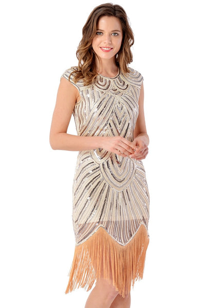 Right side view of model in apricot sequin fringed flapper dress