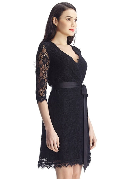 Right side view of model in black lace overlay plunge wrap-style dress