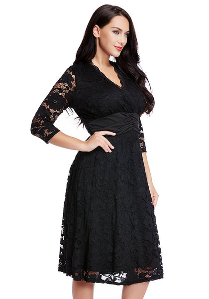 Right side view of model in black lace surplice ruched-waist dress