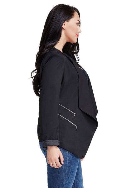 Right side view of model in black padded-shoulder draped blazer