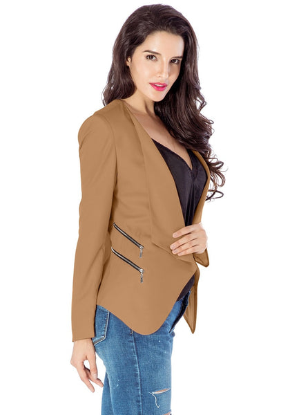 Right side view of model in champagne draped blazer