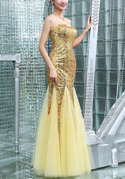 Right side view of model in gold sequin mermaid evening gown