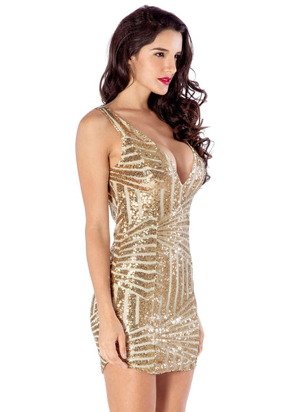 Right side view of model in gold sequin party dress