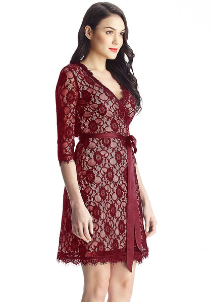 Right side view of model in maroon lace overlay plunge wrap-style dress