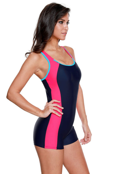 Right side view of model in navy and hot pink racerback keyhole maillot swimsuit