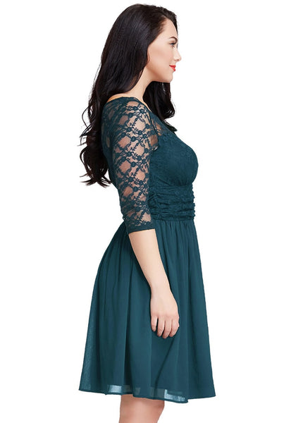 Right side view of model in peacock lace crop-sleeves skater dress